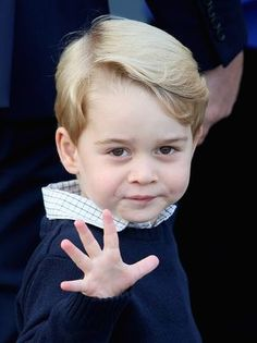 Prince George of Cambridge, who waves as he leaves