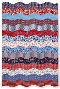 Red, white, and blue fabrics form a dramatic throw that looks as though it's blowing in the breeze.