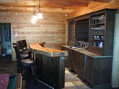 Cedar slab bar top, slate floors, wine racks, granite. http://huismanconcepts.com/