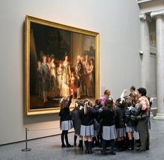 Spain. At the Prado Museum, Madrid. Charles IV Family by Goya look at the young visitors and their teacher