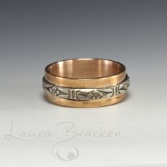Bronze is one of my favorite metals.    In this ring, I paired the warmth of the bronze with a beautiful accent of sterling silver.  The size is 8¾.  To see all my rings, click here: http://brackendesigns.com/catalog/rings   1817