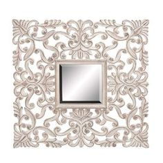 """Wall mirror with a scrolling openwork frame.   Product: Wall mirrorConstruction Material: MDF and mirrored glassColor: GoldDimensions: 35"""" H x 35"""" W x 0.5"""" D"""