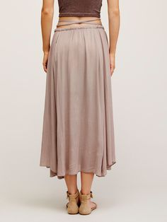 Mad About You Midi Skirt | In a long and flowy midi silhouette, this skirt features an elastic waistband with drawstring closure. Dramatic front slit reveals the mini skirt lining.