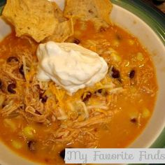 Santa Fe Chicken Tortilla Soup-Cook chicken in broth with sweet onion and cilantro chopped up. Once cooked add beans corn and salsa, spices (garlic powder, cumin and chili powder). Omit the cream cheese and add 1 can of coconut milk-Yum