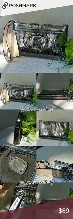 "Michael Kors Jet Set MK Wristlet clutch monogram *Authentic *NWT *Style # 35S6MTTW3Z *Mirrored Metallic Jet Set Large Wristlet, wallet, clutch *Nickel/Dark silver/Pewter color *Silver-tone hardware *Zipper closure *MK plaque on front *Measurements: 5"" H x 8.25"" L x 1"" D *7"" leather handle *Inside card holders and a slip pocket *An outer zipper compartment *UPC 190049116487  Please no trades, price is firm  Same day shipping if order is placed by 3 p.m. EST Monday-Friday  Contact…"