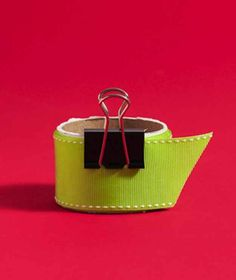 Secure ribbon with a binder clip. | 23 Tricks To Take The Stress Out Of Wrapping Gifts