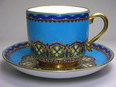 **********  Beautiful blue and gold cup and saucer