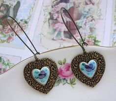 Charming Earrings....from The Vintage Heart At Etsy.   Can't live without them?   Here's a link!  http://www.etsy.com/listing/91473834/vintage-blue-guilloche-enamel-rose-heart