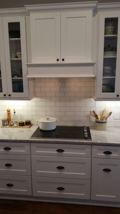 wallace kitchen after white shaker cabinetry granite thunder white handscraped hard maple floors in hemlock subway tile with a pewter grout