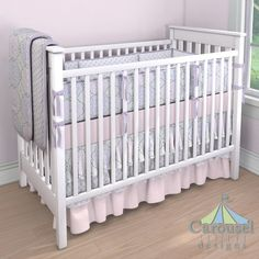 Crib bedding in Solid Pink, Lilac and Pink Nyle, Lilac Chelsea, Solid Lilac. Created using the Nursery Designer® by Carousel Designs where you mix and match from hundreds of fabrics to create your own unique baby bedding. #carouseldesigns