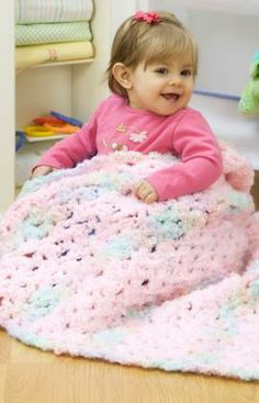 Check out the Sweet Dreams Crochet Blanket Pattern from Red Heart Yarns! It's perfect for the special little girl in your life.
