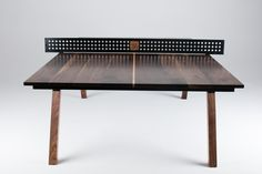 The Woolsey Ping Pong Table. In the works for over a year, and finally available after countless hours of rigorous product testing. Designed and crafted to the ITTF spec size, the Woolsey Ping Pong table is able to transform from a dining or conference table, and in a matter of seconds can be ready for game play. A solid Black Walnut top is suitable for years of play, with a Sugar Maple center line for those intense doubles matches. A regulation size powder coated steel net is easily mo...