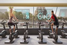 The proposed design from Carlo Ratti Associati lets passengers ride a stationary bike as they travel through Paris along the Seine River