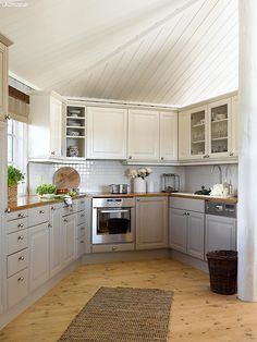 Refurbish wooden kitchen cabinets with paint. Cabin by the sea colors #JotunLady LADY Supreme Finish halvblank 1233 Mohair,LADY Supreme Finish halvblank 486 Silke