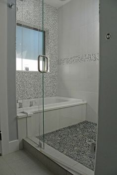 Soaking tub inside the walk-in shower!   Although I'm not sure I like the tub design.  I like the window for natural light and frameless glass wall and door.  Add a built-in seat and nooks/shelves to hold shower stuff.