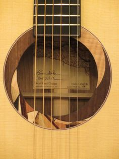 Beautiful hand done rosette inlay on custom guitar by West River Guitars