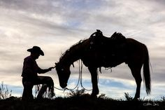 http://flatlandsfoto.artistwebsites.com/ Captured by award winning photographer Joan Davis / Flatlandsfoto during her visit to the Sombrero Ranch in Craig, Colorado. There is nothing quite like the bond between a cowboy and his horse. The sun was starting to set and the silhouette created by the cowboy and his horse told the tale best. The fabulous sky was the perfect canvas