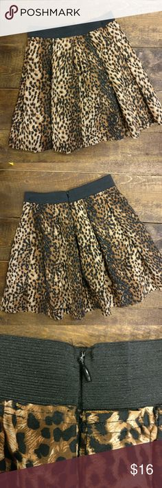 Pleated Leopard Skirt Super Cute! Inbdue Woman  Leopard print pleated skirt  Waistband has a bit of stretch  Zipper on back  Has a couple of small snags, not really noticeable, see last photo  Super cute!! Inbdue Woman  Skirts
