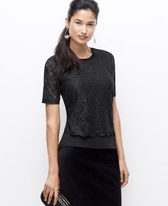 Intricate lace creates an effortlessly layered look, balanced with a delicate scalloped hem.