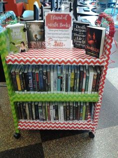 """""""Island of Misfit Books display ... I believe the sign says: These great books have been ignored and unloved. Give them a Happy Holiday and check them out!""""  (book display)"""