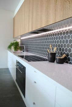 Split - Kitchen Detail White and timber, black hexagon feature tiles with recessed lighting Niche Design Build