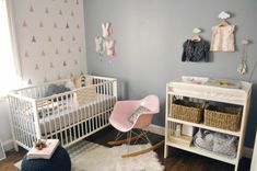baby's nursery with blue grey paint on one wall, and light colored, patterned wallpaper on the other, pink rocking chair, various decorations in pink and gray Bedroom Red, Baby Bedroom, Grey Furniture, Cool Furniture, Pastel Pink, Pink Grey, Colours That Go With Grey, Dark Grey Walls, Grey Home Decor