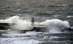 Large waves strike the harbour wall in the town of Whitehaven in Cumbia, north west England  Picture: AFP  12/11/14