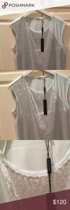 Elie Tahari ice blue sequin top Gorgeous faint blue top with soft small sequins covering the front and back of one sleeve. The back is slightly longer than the front. The top is new never worn, size small. Let me know if you have any questions! Would look perfect with white jeans or tucked into a skirt for work. Elie Tahari Tops Blouses