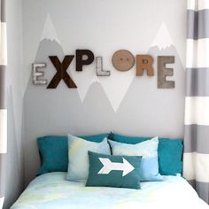 A simple painted mountain mural adds tons of personality to any kids room and makes the perfect indestructable headboard.