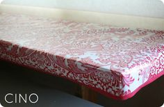 Fitted oilcloth tablecloth tutorial     edged with cute bias trim    great for a picnic table or the dining table