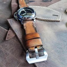 Rustic leather watch strap completely handmade from genuine Italian leather and handsewn with Irish waxed threads. Available in different sizes. Perfect for any watch.  This watch strap is Rustic style inspired, made with a neutral tan color of the leather. The edges are darkened which creates the look of an old vintage band. If you look closely you will see the strong hand stitching which gives it an authentic old look.