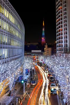 Colorful Great night lights timelapse photo in Roppongi, Tokyo, Japan shows off the city architecture. A MOST POPULAR RE-PIN. RESEARCH #DdO:) - http://www.pinterest.com/DianaDeeOsborne/intriguing-architecture/ - INTRIGUING ARCHITECTURE. Opened in 1958 as a communications & observation tower, Tokyo Tower, shown in the distant Roppongi Intersection, became symbol for the city. Made of prefabricated steel, called light because weighs only 4,000 metric tons though 333 meters / 1093 feet high.