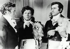 0 BEAU BRUMMELL (1954) PETER USTINOV & STEWART GRANGER with poodles in their arms next to ernest clark
