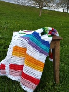 Cute baby crib blanket in an easy Crochet pattern. Mostly double crochet with easy color changes at the end of a row and a pretty edge finish.