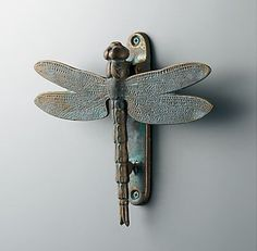 Add bohemian flair to your entrance by pairing this green-toned patina Dragonfly Door Knocker ($79) with a complementary door color like coral.