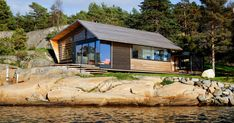 Lund+Slaatto Architects Have Designed A Cedar Clad Contemporary Waterfront Cabin In Norway