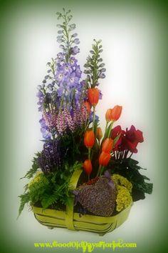 An old British garden..ferns, fresh cut stems, and a lavender heart sachet. $145.00 fresh or preserved.  https://goodolddaysflorist.com/ecoshop/product-list.php?spring_flower_arrangements-pg1-cid62.html #springflowerbasket #englishgardenbasket
