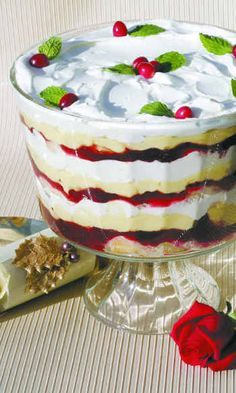This easy cranberry trifle recipe features soft cake layered with sweet tart cranberries and homemade custard. This beautiful trifle dessert is perfect for any time of year! Köstliche Desserts, Holiday Desserts, Holiday Baking, Holiday Treats, Holiday Recipes, Dessert Recipes, Christmas Recipes, Chef Recipes, Plated Desserts