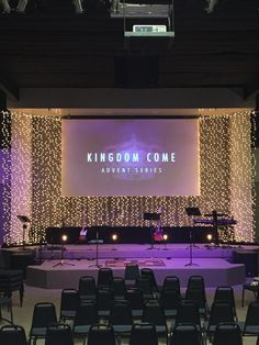 Tony Ziolko from New Community Christian Church in Salina, Kansas brings us this stage wall littered with light.Their Advent series was called Kingdom Come. They used purple lighting to go with the liturgical color scheme of advent (purple). Then they hung strands of Christmas lights from aluminum conduit pipe that they suspended from the ceiling. The sides were at an angle to add depth.