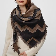 A gorgeous scarf that doubles as a wrap or blanket.