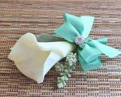 This calla lily looks and feels real. The boutonniere comes individually wrapped with attachment pins. The ribbon can be any color you need just let me know what color you need.