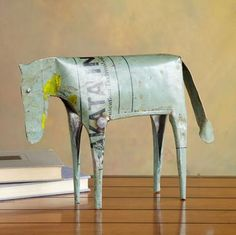 """Making horse sense, this primitively-inspired horse is cut from recycled steel drums. Each is unique, with graphics from the drum still visible. Priced to permit your very own herd. Imported. 14""""W x 2-1/2""""D x 8""""H."""