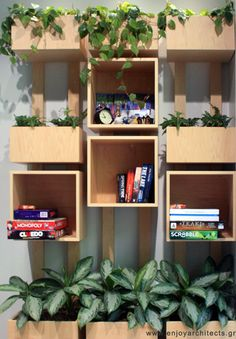 a cool bookcase and planter designed by Paraskevi Papasotiriou of enjoy architects for Polis Apartments Hotel