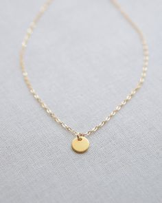 Tiny gold disk on a gold necklace. This is THE perfect necklace for everyday wear. By Olive Yew.