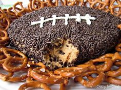 Peanut Butter Football Dip  ¼c butter,soft  4oz cream cheese,soft  1c pnut butter(crunchy/smooth)  ½tsp vanilla extract  1½-2c powder sugar  ½c mini choc chips  Choc sprinkles for icing    1.Cream butter/cream cheese/pnut butter(hand-held mixer). Mix in vanilla  2.Add powder sugar, ½c @ time, mix to combine. Mix in choc chips  3.Put mix on wax paper. Use hands to form football  4.Place on serving plate,cover w/sprinkles,press into surface. Pipe on laces w/melted wh choc, chill til ready to serve
