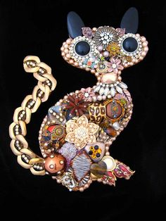 This fabulous kitty cat, Samia, is hand layered with rhinestones, freshwater pearls, earrings, brooches, metal chain, vintage earrings, brooches and more. Samia measures 11 x 7 inches and is made on a wood foundation with a hook on the back, already to hang. Stunning!  What Makes ArtCreationsByCJ stand apart from other jewelry art:  * HIGH QUALITY. Art Creations are NOT glued to a piece of fabric or velvet or some average store bought frame. They are made on a 1/4  wood foundation. The wood…