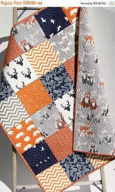 Hey, I found this really awesome Etsy listing at https://www.etsy.com/listing/257679290/baby-quilt-boy-orange-navy-blue-gray-elk