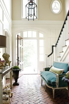 Traditional Entryway with Crown molding, herringbone tile floors, Transom window, High ceiling, Chandelier