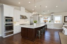 Open concept kicthen with white marble island.