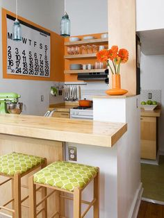 Palette Perfection. Too much color can close in a small space. The combination of a neutral base with citrus accents opens up this small kitchen. A bold orange stripe around the kitchen adds a pop of color without being overwhelming and also highlights items in the kitchen, such as the family calendar. Hints of green on the stools and the kitchen appliances add to the room's overall zest.
